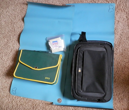 An aerial shot of the carrying cases for the SCIO and the laptop